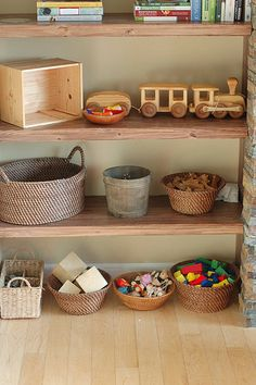 Woven baskets as storage bins. Great way to stay organized.