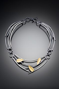 Symmetrical styledn Neklace by Lori Gottlieb. 'Sticks and Petals'. Sterling silver and 22k gold bimetal.