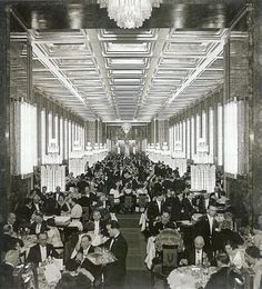 Normandie's famous mirrored with Lalique lighting fixtures and a golden coffered ceiling dining room.