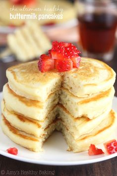 The Ultimate Healthy Buttermilk Pancakes -- so light & fluffy! These are WAY better than any pancakes I've ever had! They don't taste healthy at all! #buttermilkpancakesrecipebutter