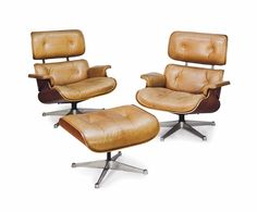 A PAIR OF ROSEWOOD AND TAN LEATHER-COVERED '670' LOUNGE CHAIRS AND A '671' OTTOMAN, DESIGNED BY CHARLES AND RAY EAMES IN 1956 FOR HERMAN MILLER, OF LATER MANUFACTURE