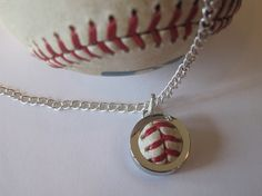 Love this! I want one! Authentic Game Used Baseball Pendant & by bottomofthe9thonline, $49.00
