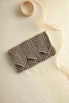 Handmade crochet detailing can add even more of a personal feel to your wedding from creative ideas for place cards to crochet wedding dresses and bridesmaids gifts.