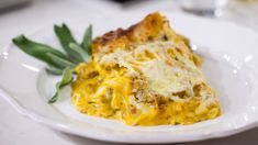 Layers of creamy pumpkin and spicy Italian sausage make this lasagna a perfect fall comfort food.