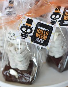 Wants and Wishes: Party planning: Eek, Shriek and be Scary Halloween Collection.  Base is a brownie covered with chocolate ganache, stacked white pretzels, and marshmallow with skeleton face drawn on with edible black ink--finished off with a printable skeleton tag!  Check out the candy corn apples and dessert bar there too!