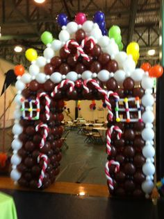 Gingerbread House balloon arch by Lisa Swiger of Blooming Balloons, Raleigh, NC: