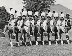 "Title ""The NCCU Sound Machine"" Majorettes  Subject Bands  Majorettes  Students  Activities  Organizations  Description A photograph of majorettes in ""The NCCU Sound Machine.""  Author/Creator [Unknown]  Date.Original 1960-01-31  Learn more about African American History and Photography at ""Through A Lens Darkly"" TALD documentary and multimedia project - Digital Diaspora Family Reunion DDFR www.DDFR.tv.   Upload and share your own family photographs and stories at ddfrsocialnet.ning.com !"