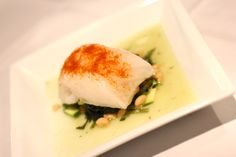 Chilean Sea Bass, served over a bed of wilted greens, zucchini & white beans. At Yianni's Taverna & Euro Lounge in Bethlehem. PA.