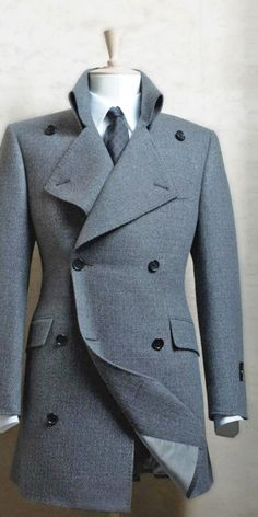 Military style, high collared, fitted double-breasted peacoat. Oui.