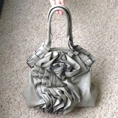 Large gray bag Cute Gray bag. In great condition.  Zip and button closures on top. Inside is clean..no stains.  No trades. Bags