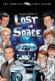 Lost in Space (1965–1968)   A space colony family struggles to survive when a spy/accidental stowaway throws their ship hopelessly off course.   Creator: Irwin Allen  Stars:June Lockhart, Mark Goddard, Guy Williams, Billy Mumy, Angela Cartwright, Jonathan Harris, Marta Kristen, and Dick Tufeld .as The Robot