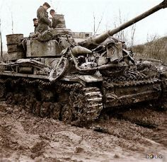 Panzer IV with a dispatch rider's or a recon rider's motorcycle on the front of the tank. Unusual, as the bow machine gun cannot be fired with the bike in that location. Could possibly be helping the rider get through the deep mud of the Eastern Front, a constant hinderance the all vehicles.