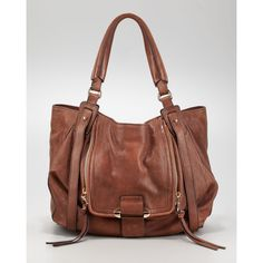 Soft brown leather updates the Kooba signature style, but the slouchy silhouette maintains the Jonnie hobo's requisite carry-anywhere appeal. Smooth leather. P…