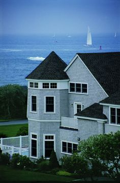 Amazing shot of this ocean side house featuring elegant Andersen 400 Series Tilt Wash Double Hung Windows.