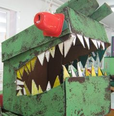 Dinosaur head using an A4 paper box, yogurt pots and cardboard triangle cut outs.