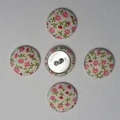 "Superb Quality Fabric Covered ButtonsPacks of 5 or 10 buttons (subject to availability) Each button is 20mmFabric on metal shellLoop shank.Ideal for dressmaking, craft, jewellery or curtain headers etc.Note:Can be supplied without shank / flat metal back. Please email.Exact positioning of the pattern may vary slightlyLocally made, and unbranded, using fabric as described.SaveNeed more than 5 buttons? Use the ""10 button"" option where available"