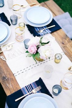 Relaxed dinner party setup accented with florals