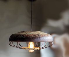 Vintage chicken feeders turned into industrial chic lamps. Nice.