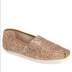Gold Sparkly Toms Only wore these Toms once! Look brand new. The size is a 9W TOMS Shoes Flats & Loafers