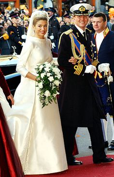 Queen Maxima of the Netherlands married in a simple long sleeve ivory Valentino gown.