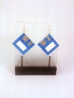 Floppy disk style earrings available in a range by PuffyTheSlayer