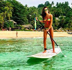 Izabel Goulart wearing her La Fama bikini while paddle boarding in Phuket, Thailand. STUNNING!! You look so amazing Iza!!  http://www.lulifama.com/category/L385.html