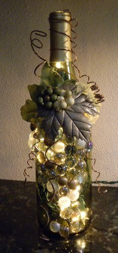 Decorative Embellished Wine Bottle Light with Leaves by booklooks(Bottle Painting With Lights) Wine Bottle Glasses, Empty Wine Bottles, Recycled Wine Bottles, Wine Bottle Corks, Glass Bottle Crafts, Painted Wine Bottles, Lighted Wine Bottles, Bottle Lights, Beer Bottles