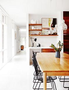 kitchen office nook. Monochromatic kitchen; white walls & floor, natural wood & black accents.