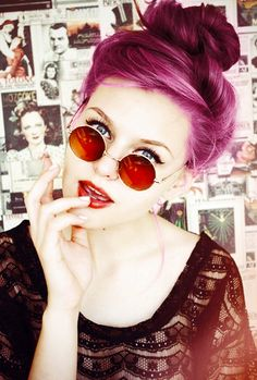 Those ROUND sunglasses are SO entertaining. Buns like those match perfectly too. The purple hairdo can only look great on the perfect faces though. Vintage is a needed feeling.