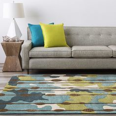 Cohesive and contemporary living space complete with pillows, lamp and rug from Surya!