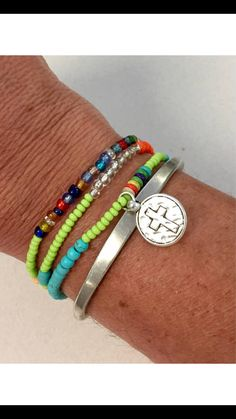 One of my fav wrap bracelets or necklace.  Goes with so many outfits with all the colors and gemstones.  A cross is the single charm dangling from it.  Where is alone wrapped or with other bracelets.