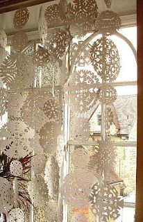 Winter Decorating - Decorating with snowflakes. We've used this idea in the past for a Holiday party. The effect of multitudes of these simple paper snowflakes hung overhead is ethereal. Our guests were very impressed.