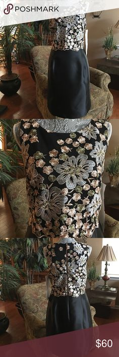 """Ivanka Trump Sz 12-Lace Floral Top Flare Dress-NWT Adorn yourself for a wedding, fancy dinner party, banquet or any dressy affair in this sophisticated and chic dress. You will look and feel like the """"Bell of the Ball"""". It has a fit and flare silhouette with a floral embroidered top with metallic threads. There are two zippers in the back, one for the entire dress and one for the overlay of Lace. The skirt has a flare that looks like it is made of satin, although it is polyester.  The dress…"""