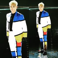 Any celebrity can wear a suit BUT a Mondrian inspired suit is ONE of a KIND! Just like T.O.P a blond one that is...with black gloves!