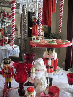 Purple Chocolat Home: Nutcracker Sweets Tablescape. It would be awesome to have a nutcracker cake stand.