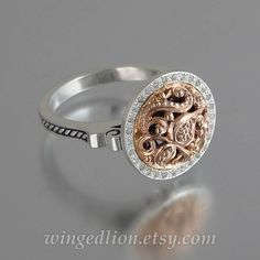 This stylish ring was designed and crafted by the artist and jewelry designer Sergey Zhiboedov (my husband). It will be made to order in the size specified by the customer in silver and 14k rose gold. OLGA ring is adorned with beautiful floral carvings inspired by traditional Russian