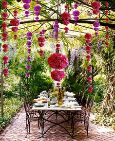 An outdoor dining area decorated with paper garland