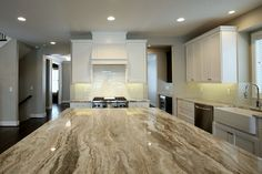 Brookhaven White Cabinets and Fantasy Brown Marble, Vervisch Homes and BSB Design Granite Countertop Designs, Kitchen Design Countertops, Kitchen Design, White Backsplash, Brown Granite, Granite Kitchen, Countertops, Kitchen Style, Brown Granite Countertops