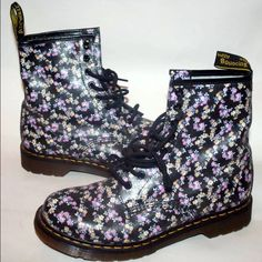 """Dr Martens SZ 10 Black Floral Leather Rain Boots Authentic Dr. Martens. Size 10 (US).   Preowned, not in original box. excellent condition. Heel height is about 1.25"""". Size 10 (US).   These Dr. Martens boots are ankle high and have an adorable floral print all over them.   Made from the finest leather with cushioned footbed for added comfort.  Original price: $140  This boot is perfect for any fall or winter weather, even the rainy kind! Dr. Martens Shoes Ankle Boots & Booties"""