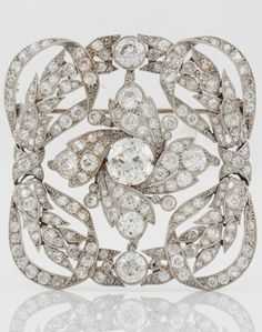 A large Belle Epoque platinum and old-cut diamond brooch, probably by Cartier. Made in France in 1910 according to hallmarks. Original box from Cartier, made between the years 1907 and 1917. Size of brooch 50 mm x 50 mm. #BelleÉpoque #Cartier #brooch