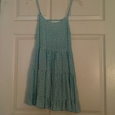 Adorable sun dress! Very comfortable. Super cute! Worn a handful of times. The last picture shows the back of the dress (it has a strap that goes across the back) Mine Dresses Mini