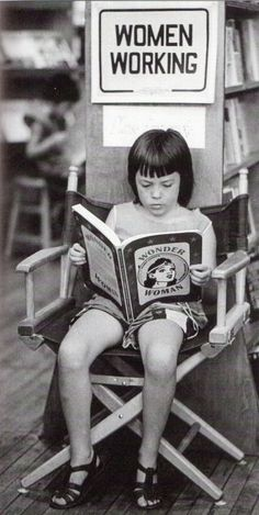 """Girl reading Wonder Woman book under a """"Women Working"""" sign at the New Words Feminist Bookstore in Cambridge, MA. People Reading, Woman Reading, Book People, Good Books, Books To Read, Reading Books, Cool Baby, Wonder Woman, Lectures"""