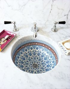 Snyder blended Italian and Moroccan influences in the painted porcelain sink basins featured in each guest bathroom. Snyder blended Italian and Moroccan influences in the painted porcelain sink basins featured in each guest bathroom. Moroccan Bathroom, Moroccan Decor, Moroccan Interiors, Bathroom Styling, Bathroom Interior Design, Italian Interior Design, Modern House Design, Home Design, Design Ideas