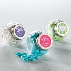 Filled with candy and personalized with one of our custom-designed labels, these reusable glass candy wedding favor jars are a sweet treat for your guests.