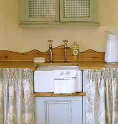 A skirted sink adds casual vintage flair and conceals insightly cleaning items in this mudroom.   Photo Polly Wreford   myhomeideas.com
