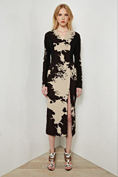 Rachel Roy - My 3 Faves From Resort 2014 http://toyastales.blogspot.com/2013/06/rachel-roy-my-3-faves-from-resort-2014.html The cut of this midi dress could come off as a little too demure if not for the alluring slit in front. It modernizes the dress along with the graphic abstract print. The abstract print is what initially drew me to the dress, and because of the large scale it might not have worked if it was used in a brighter color palette...Click On Link to Read More