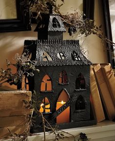 halloween lighted house with skeleton by raz imports have fun with this amazing haunted house this creepy structure features an orange gli