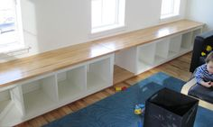 window bench with ikea expedit bookshelf idea with wood top. gets rid of 'storage or seating' poser. could use the old library cabinet wood...