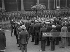 King George V (1865 - 1936, centre, left) meets employees of the Gas Light and Coke Company at Beckton in east London, July 1926. The king and Queen Mary are at the site to to open the company's new coal handling plant.
