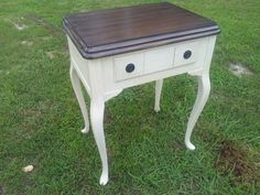Classically elegant tall side table finished in Valspar Woodrow Wilson Presidential White with Cabot Water Based Midnight Stain.  Finished with Dark Wax and Poly. $125